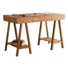 """One-drawer desk with sawhorse-style legs and two lower shelves.   Product: Desk  Construction Material: MDF, oak veneer and pine    Color: Oak  Features:   One drawer Two shelves     Dimensions: 31"""" H x 47.25"""" W x 23.5"""" D"""