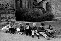 MILAN, Italy—Children reading comics, 1997.  © Ferdinando Scianna