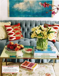Light blue velvet sofa with great accent colors as seen in House Beautiful, designer Melissa Warner of Massucco
