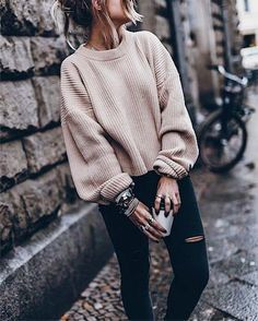 oversized sweaters for the win -I love how she folded the sleeves at the bottom a bit in a casual way.
