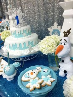 Amazing cake and cookies at a Frozen Olaf birthday party! See more party planning ideas at CatchMyParty.com!