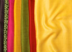 Scarves ans shawls in colorful color scheme, including yellow,red,green and pink. Buy silk, chiffon, cashmere or wool shawls for both women and men exclusively from Le Patio. #scarves #shawls #warm #yellow #red #green #women #fashion #silk #cashmere