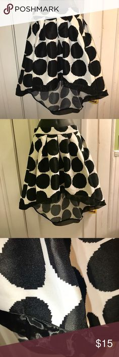 """NWT Garcia B/W Skirt size S Gorgeous full dressy black and white skirt with tulle edging at hem. Skirt is 18"""" long in front and dips to about 27"""" in back. Zip closure. Waistband is 13"""" across. Gracia Skirts High Low"""