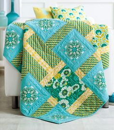 Designer Tony Jacobson based this floral and solid quilt pattern on an English formal garden. To the Manor Grown is featured in the July/August 2013 issue of Fons & Porter's Love of Quilting.