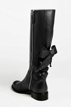 Black riding boot with a bow!  Omg I would have to wear these every day.