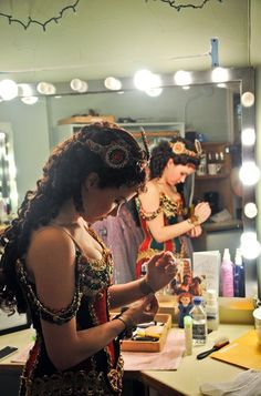 Five minutes to curtain! Boggess slips on her jeweled bracelets and gets ready to go.