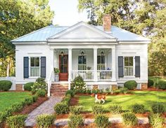 How sweet is this cottage?  I would live most of my life on this wonderful front porch!  This 800 square foot cottage is located right outside of Tallahassee, Florida.  It was designed by architect…