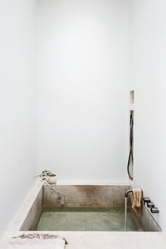 Michael Scherrer Bath by Matthew Williams for Remodelista (cast concrete tub inspired by ancient submerged Crete baths)