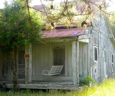 Just love this old and worn farmhouse...and the swing on front porch..Lots of memories made here......
