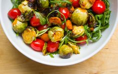 Feel-Good Vegan Sriracha-Roasted Brussels Sprout Salad! This easy dish us under 10 ingredients and is entirely plant-based. It's also gluten-free and is perfect for the holidays or any time of year. This salad has got a wonderful variety of textures and a really fantastic kick to it and keeps well for days if you want to enjoy it in veggie bowls throughout the week.