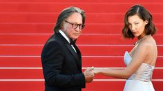 """Mohamed Hadid and model Bella Hadid, his daughter, arrive for the screening of the film """"Ismael's Ghosts"""" at the Cannes Film Festival in southern France this month."""