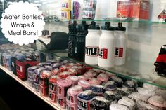 Get your Title Boxing Club gear: meal bars, hand wraps and water bottles.