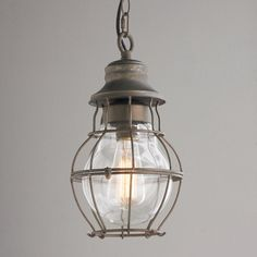 "Metal Cage and Closed Glass Pendant Stylized like an antique lantern yet has a modern industrial tone. The contoured metal cage of this pendant is perfect for a kitchen or utility room. 60 watts, medium base. (14""Hx8""Wx8""D)"