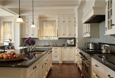 Warm White Kitchen -love the floors and cabinetry