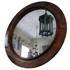 """This is an antique sand mold form used as a model for an iron machine part. It A mold would have been made from it and then the iron would have been poured into the mold to make an iron ring. We have put a piece of distressed mirror in it. It had a rings and wire on the back for hanging. We do have other sizes and wood finishes available. No two are alike.  58""""diameter"""