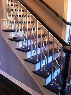 Wrought iron stair railings- put new decoration in between the railing that are too wide :)