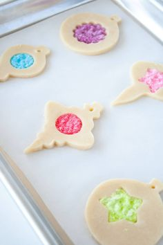 Cookie and candy all in one! Learn how to make stunning stained glass cookies with this detailed tutorial. Perfect for holiday cookie exchanges or for hanging on your tree! | livforcake.com