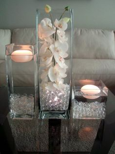 Teal/ Turquoise hand painted Orchids in 3 Pc. Vase and floating candles. Wedding Centerpieces, Wedding Decorations, Table Decorations, Centerpiece Ideas, Purple Centerpiece, Vase Ideas, Elegant Centerpieces, Water Beads Centerpiece, Flower Centrepieces