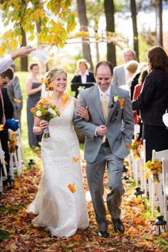 What a great idea!  Have the guests throw colorful fall leaves!  We could get glycerined oak leaves in all sorts of colors--and they would be clean and bug free. :)