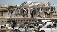 Death Toll In Moore Tornado Down To 24  OKLAHOMA CITY – The death toll in Moore, a suburb of Oklahoma City, Oklahoma, which was devastated by a super tornado on Monday, has been reduced from originally 51 to 24.