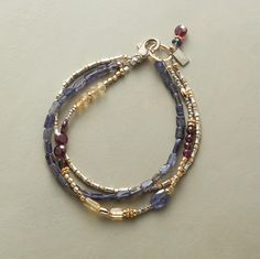 """THREE OF A KIND BRACELET--What do iolite, garnets and citrine have in common? They all look beautiful on you, especially in a handmade bracelet lit up with sterling silver, 14kt gold-filled and 18kt gold vermeil beads. USA. Sterling silver lobster clasp. Exclusive. 7-1/2""""L."""