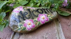 Painted garden rock with Welcome and flowers by MyPaintedSwan