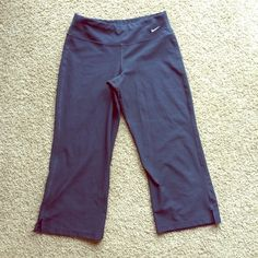 Navy blue Nike capris These navy blue capri pants are in excellent condition with no flaws. They are Nike dri fit made of a polyester/ spandex blend. Perfect for any exercise Nike Pants Capris