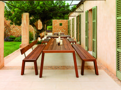 Solo, designed by Wim Segers for Viteo - Austria. Bold contemporary design dining furniture, suitable for exterior or interior use. Solo is made from slid iroko, with fixtures and fittings in 316 stainless steel.
