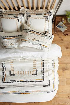 Embroidered and patchwork Anthropolgie duvet. Beautiful bedding!