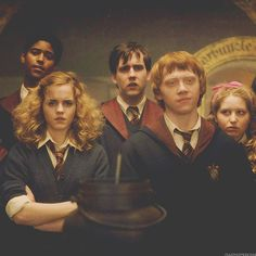 Potions class. the best part about this is Hermoine's hair.