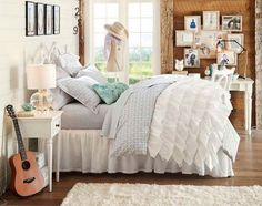 A bedroom and study space in one. Love the soft gray with simple white color scheme and the opo of throw pillows.