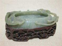 Sale D240316 Lot 305  A 20th century Chinese nephrite jade brush washer with wood stand, 12cm (4.75 in) wide (2)  - Cheffins