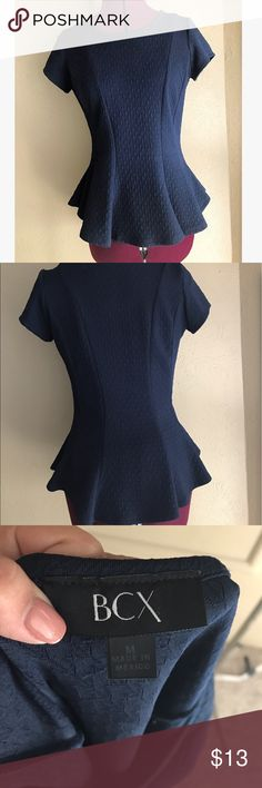 Navy Peplum Top This top is ultra soft and comfortable! It feels like wearing a tee shirt, but you look just a little more dressed up. Can easily swing between casual and business! In great condition! Purchased at Macy's. REASONABLE OFFERS WELCOME BCX Tops Tees - Short Sleeve