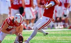 University of Nebraska punter Sam Foltz and former Michigan State University punter Mike Sadler were killed in an automobile crash in Merton, Wis., late Saturday night.