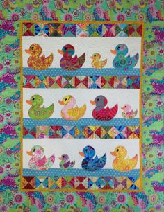 JUST DUCKY #1 QUILT PATTERN  Quilt finishes at 37 x 49 - but can easily be made larger or smaller.  Condition: New©  Simple piecing and