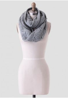 This beautifully crafted dusty teal infinity scarf features a checkered pattern on one side and a diamond-shaped, open-knit design on the other. Perfect for keeping warm during the colder month, this cozy accessory can be layered over dresses or blouses for added texture.<br /> <br /> 70% Acrylic, 30% Cotton<br /> Imported