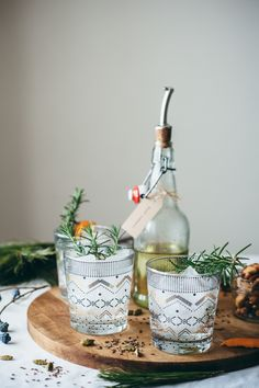 Aquavit and Rosemary Cocktail - Aquavit, Rosemary Syrup (Recipe), Fizzy Water, Sprig of Rosemary and a Twist of Orange Peel.