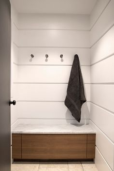minimal bathroom with oak and white tile