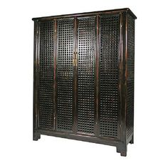China.  Elm Wood Lattice Armoire. Intricate Elm wood Lattice Work fully surrounds this beautiful piece.  Double hinged doors open to large shelves and drawers that open to storage.  Perfect for an entertainment center or display cabinet.  Finished in a dark brown and black lacquered patina.  Here at design MIX furniture we offer studio rentals of all of our one of a kind pieces. If you have any questions about this piece or any of our art and furnishings, please contact us.