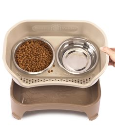 The Neater Feeder ($19.99 to $24.99 for the small, $39.99 to $44.99 for large,  amazon.com is a gift for both the pet and the owner. It makes spilled food and water easy to clean up and also reduces neck strain for the animal.  - GoodHousekeeping.com
