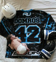 Baby hockey picture with hubby's jersey