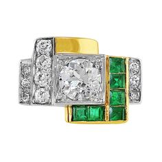 2.27ct Estate Diamond Emerald Art Deco Ring. 18k yellow gold estate Art Deco style ring set with a center round brilliant cut diamond weighing 2.27cts and SI1 clarity, and side diamonds and emeralds. The side diamonds weigh approximately 0.64cttw and the emeralds weigh approximately 0.48cttw.