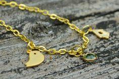 One Artsy Mama - http://www.oneartsymama.com/2014/07/little-bird-charm-bracelet.html