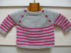 Langoz is a seamless baby sweater knit in the round from the top down. The upper back and front are worked flat, then pieces are joined and the striped body is knitted in the round. Sleeves are put on holders before being knitted in the round as well.