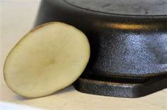 Remove rust stains from your pots & pans  Cut a potato in half dip it in water and then dip into baking soda. Rub potato onto the area and voila!!