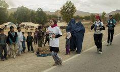 Afghanistan's female marathon runner defies danger to go the distance.