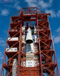 S67-15885 (1967) --- Apollo Spacecraft 012 is hoisted to the top of the gantry at Pad 34 during the Apollo/Saturn Mission 204 erection.