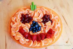 Jack-'O-Lantern Fruit Plate for Fall Harvest Halloween Party for kids. Cute, tasty and healthy!
