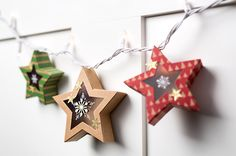 Use the Stars Framelits to die cut windows in your Many Merry Stars kit and add them to a string of Christmas lights for an adorable garland!