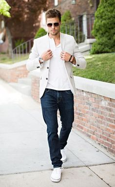 Men's casual outfit - dark blue jeans, white t-shirt, beige blazer, white sneakers and sunglasses.   See the cities with the most handsome guys >>> checkered shirt